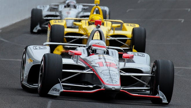 Team Penske IndyCar driver Will Power (12) leads a groups of cars into the first turn during practice for the Indianapolis 500 at the Indianapolis Motor Speedway on Wednesday, May 16, 2018.