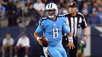 Tennessee Titans quarterback Marcus Mariota (8) runs for a first down in the first half against the Jacksonville Jaguars at Nissan Stadium.