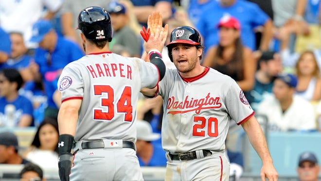 Bryce Harper and Daniel Murphy celebrate in the ninth inning.