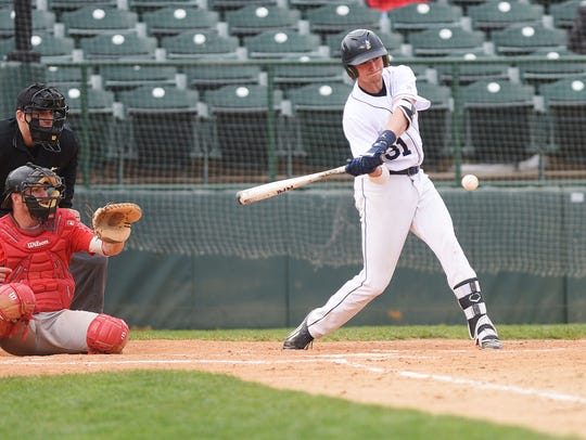Augustana's Jordan Barth hits a home run during the