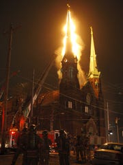 Fire engulfed the steeples of Old St. George Church in Corryville on Feb. 1, 2008.