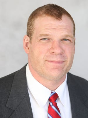 Glenn Jacobs owns an insurance firm in Halls and is a candidate for Knox County Mayor in 2018. He is a pro wrestler who performed under the name of Kane.