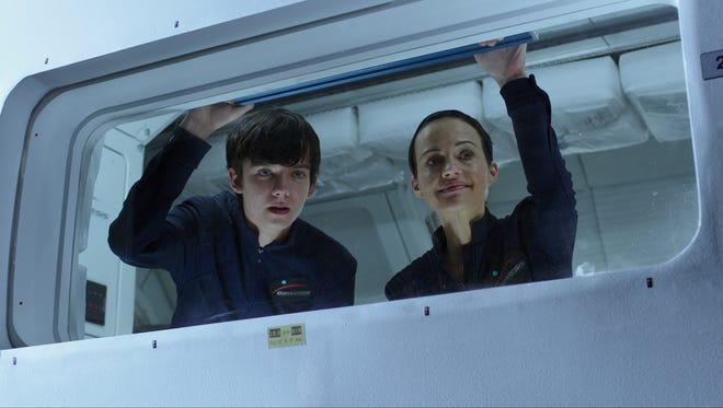 "Asa Butterfield (left) and Carla Gugino star in ""The Space Between Us."""