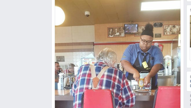 Evoni Williams, 18, was working at the Waffle House in La Marque, Texas, Saturday, when her customer, Adrien Charpentier asked her to help him cut his food.