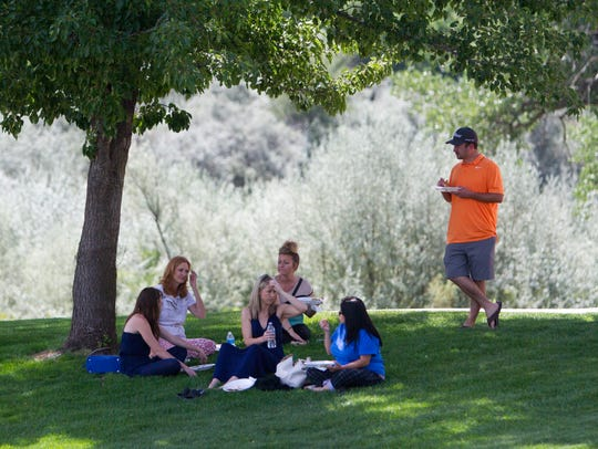 Local Realtors enjoy lunch under a tree July 19 during the inaugural Realtor Rally hosted by the San Juan County Board of REALTORS at the Farmington Museum at Gateway Park.