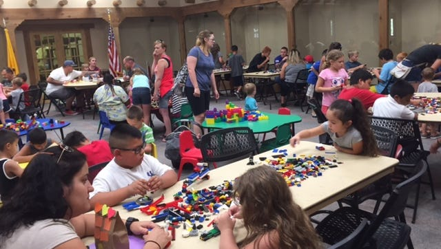 Children join in Lego Club activities at the Carlsbad Public Library. The Club is one of numerous summer events hosted at the library.