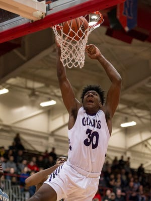 Ben Davis High School senior Aaron Henry (30) puts up a shot during the first half of the championship game in the 2018 Marion County Boys' Basketball Tournament at Southport High School, Monday, January 15, 2018.