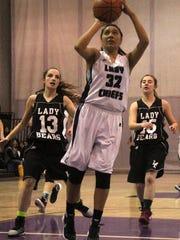 Katelyn Yuzos puts up a shot on Thursday night at the Mescalero Apache School gymnasium.