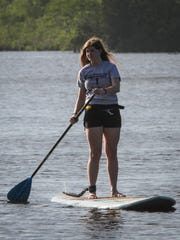 Kayaks and SUPs (Stand Up Paddleboards) from Jersey Paddler on Forge Pond in Brick. Megan Tesch - employee at JP.