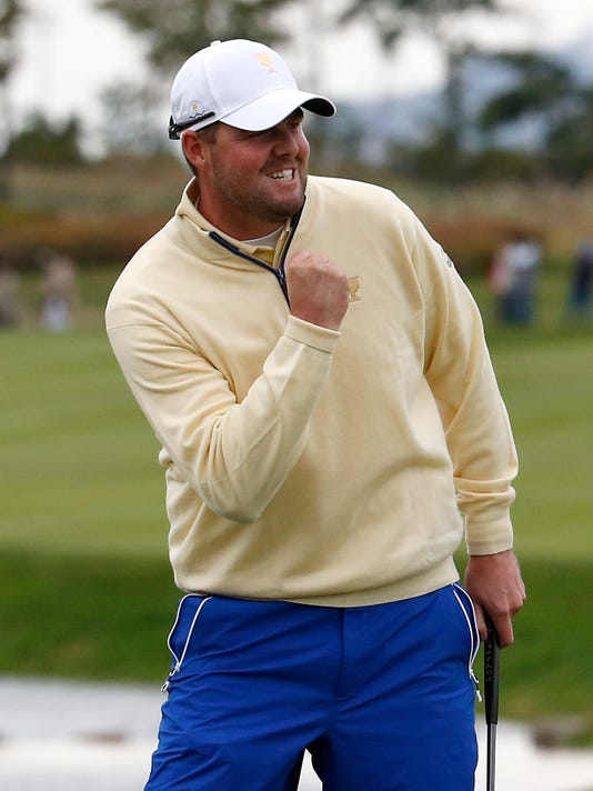 International team player Marc Leishman of Australia reacts after sinking a putt on the 18th green to defeat United States' Jordan Spieth 1up in their singles match at the Presidents Cup golf tournament at the Jack Nicklaus Golf Club Korea, in Incheon, South Korea, Sunday, Oct. 11, 2015.(AP Photo/Lee Jin-man)