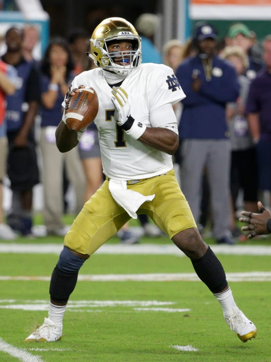 Notre Dame quarterback Brandon Wimbush (7) stands back to pass during the first half of an NCAA college football game against Miami, Saturday, Nov. 11, 2017, in Miami Gardens, Fla. (AP Photo/Lynne Sladky)