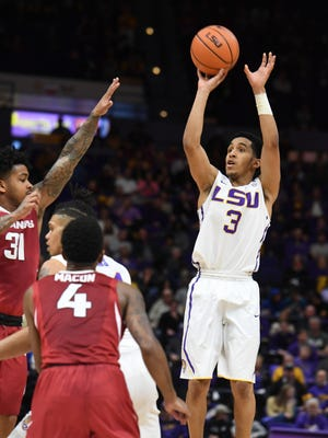 LSU's Tremont Waters (3) shoots a three-point basket in the first half of an NCAA college basketball game against Arkansas in Baton Rouge, La., Saturday, Feb. 3, 2018. Arkansas' Anton Beard (31) defends. (Patrick Dennis/The Advocate via AP)
