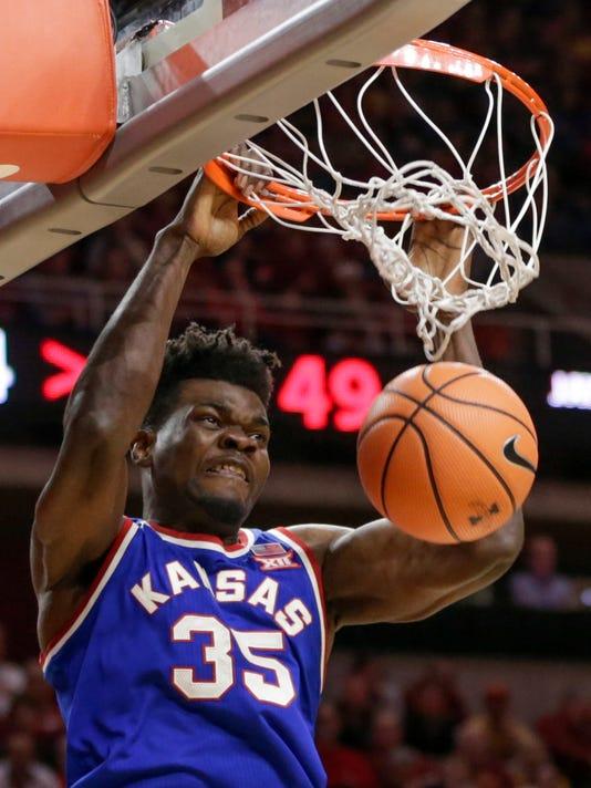 Kansas' Udoka Azubuike dunks during the second half of the team's NCAA college basketball game against Iowa State in Ames, Iowa, Tuesday, Feb. 13, 2018. (AP Photo/Nati Harnik)