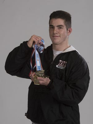 Tate High junior Nathan Golmon, chosen as PNJ Wrestler of the Year, matched the school's best finish with his second-place medal at the Class 2A state tournament and also equalled one of best finishes of any area wrestler in history.