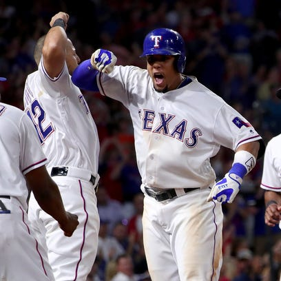 Rougned Odor celebrates his two-run homer with with Adrian Beltre on Wednesday night.