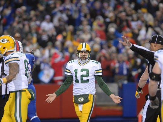 Green Bay Packers quarterback Aaron Rodgers (12) tries to find out what happened on his late game fumble that resulted in a Bills safety that sealed the Packers loss against the Buffalo Bills at Ralph Wilson Stadium in Orchard Park, N.Y., December 14, 2014.
