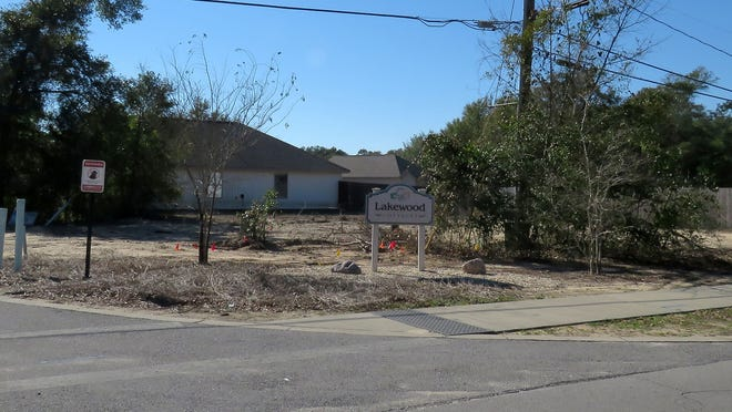 View of the entrance to the Lakewood Cottages development off of Weis Lane just west of the Bayou Chico bridge.