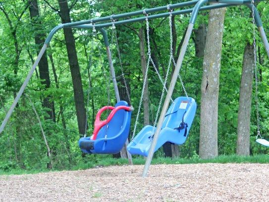 Disability-friendly swings seen at Shimek Elementary's
