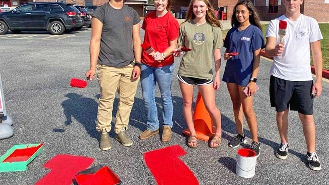 Members of the BHS Pep Squad painted the red horseshoes around the school's parking lot.