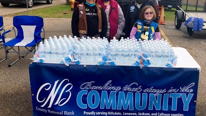 Girl Scout Troop 60128 and County National Bank in Jonesville provide water for the Fall Fest held Oct. 22.