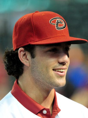 First overall pick in the 2015 MLB draft Dansby Swanson looks on after signing with the Arizona Diamondbacks.