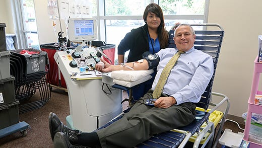 Sen. Kip Bateman donating during the last blood drive he hosted at the Steeplechase Cancer Center in October, 2017.
