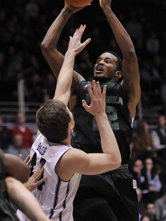 Loyola Maryland's Cam Gregory, right, goes up for a shot against Northwestern's Gavin Skelly, left, during the first half of a basketball game Sunday, Dec. 27, 2015, in Evanston, Ill. (AP Photo/Paul Beaty)