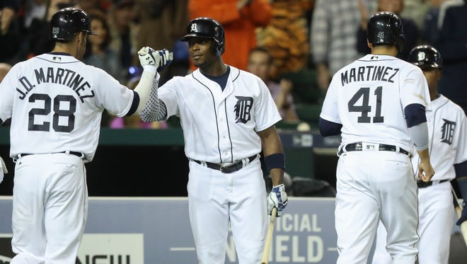 Detroit Tigers' J.D. Martinez is met by Justin Upton after his two-run homer against the Cleveland Indians' Corey Kluber during second inning action Monday, September 26, 2016 at Comerica Park in Detroit.