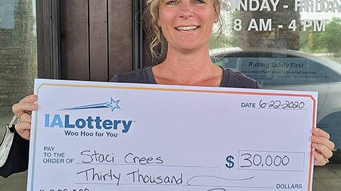 Staci Crees, of Earlham, claimed the big prize in the '$300,000 Platinum Cash' scratch game. CONTRIBUTED PHOTO
