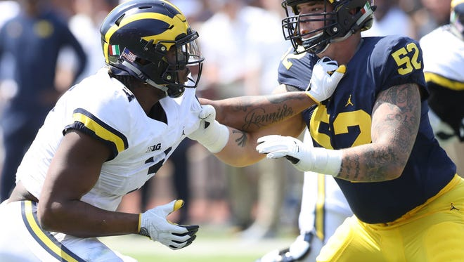 Michigan defensive end Rashan Gary rushes against Mason Cole during the U-M spring game on Saturday, April 15, 2017, at Michigan Stadium.