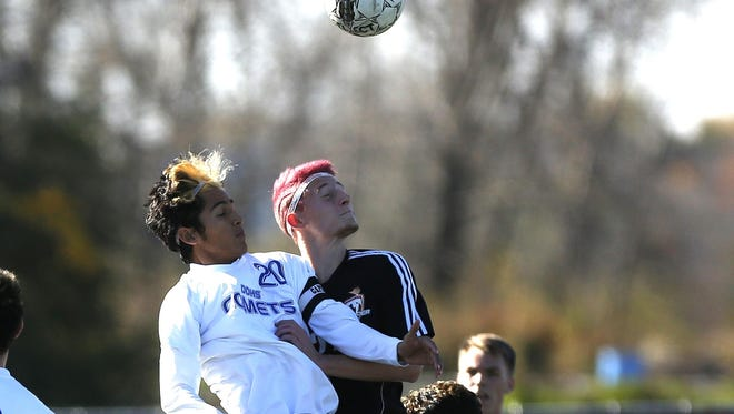 Seymour's Dalton Lehrer, right, was chosen as the Bay Conference Defensive Player of the Year for boys soccer.