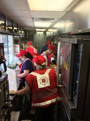 Gene Kelley works with a crew of Salvation Army volunteers during a training exercise to prepare to feed people in Houston after Hurricane Harvey's devastation.