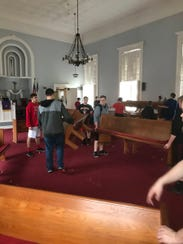 New Richmond's football team moves pews at the Presbyterian