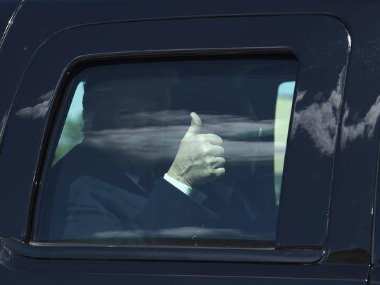 President Donald Trump gives thumbs up as his motorcade arrives at Air Force One at Andrews Air Force Base , Md., Monday, April 15, 2019. Trump said Monday that migrants caught crossing the southern border into the U.S. will be sent to so-called sanctuary cities if they can no longer be legally detained.