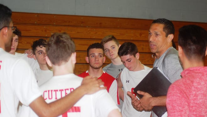 Fair Lawn coach Peter Zisa (right) talking to his team after defeating Wayne Hills, 25-6, 25-16, on April 26.
