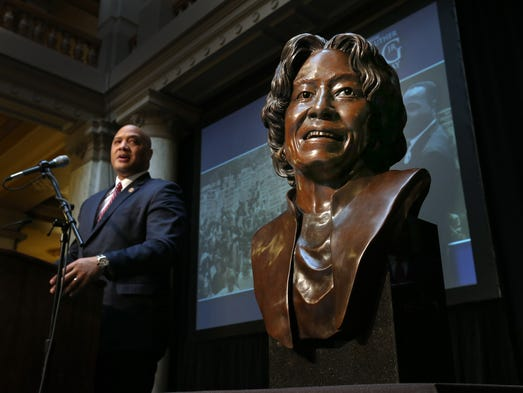 US Representative Andr? Carson delivers a speech after a bust of his grandmother Julia,right, was unveiled. The 23rd Annual Dr. Martin Luther King Jr Indiana Holiday Celebration Thursday afternoon at the Indiana State House.