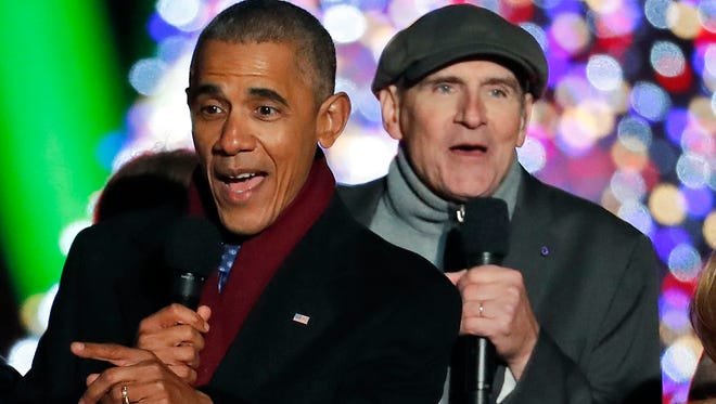"In this Dec. 1, 2016 file photo, President Barack Obama sings ""Jingle Bells"" with James Taylor during the lighting ceremony for the 2016 National Christmas Tree on the Ellipse near the White House in Washington."