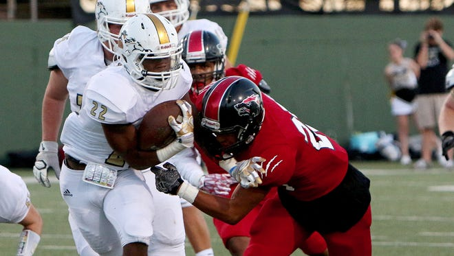 Rider's Brandon Bolton (22) sheds a tackle attempt by Wichita Falls High's Isaiah Cherry on Oct. 6 at Memorial Stadium.