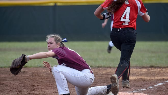 Licking Heights' Emily Meidl retires a Pleasant base runner during a doubleheader earlier this season.