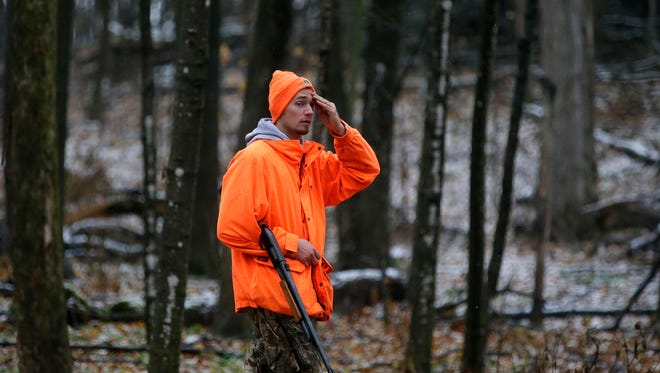 Marcus Feucht of Appleton hunts on the opening day of last year's gun deer season