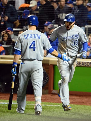 Eric Hosmer, right,  celebrates with Alex Gordon after scoring in the 8th inning.