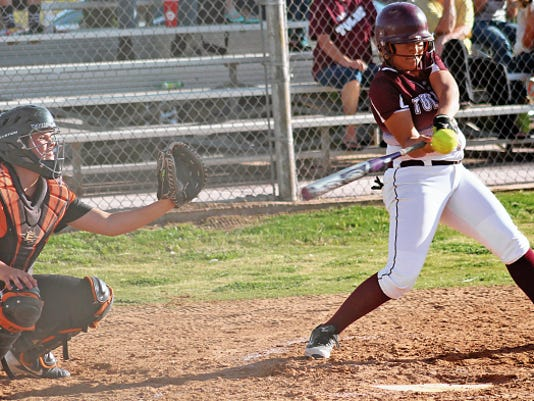 Peter Dindinger — Daily News Alicia Cuellar swings at a pitch Tuesday afternoon at the Tularosa High School softball field.