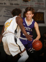 Shasta High's Caden Turner, right, tries to take the