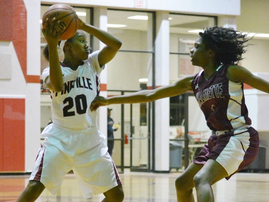 Pineville's Catina Hayes (20, left) looks to pass to