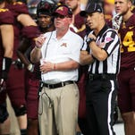 Minnesota Golden Gophers head coach Jerry Kill watches a replay on a fumble by Minnesota running back David Cobb (27) in the second quarter during their NCAA football game against San Jose State on Saturday, Sept. 20, 2014 in Minneapolis.(AP Photo/Andy Clayton-King)