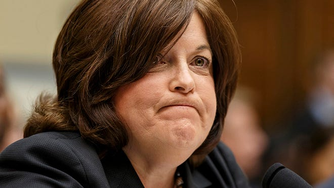 Secret Service Director Julia Pierson is questioned on Capitol Hill in Washington, Tuesday, Sept. 30, 2014.