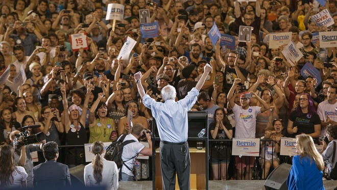 Democratic presidential candidate Sen. Bernie Sanders, I-Vt., lifts his arms in celebration as he speaks at a rally, Sunday, Aug. 9, 2015, at the Moda Center in Portland, Ore. (AP Photo/Troy Wayrynen)