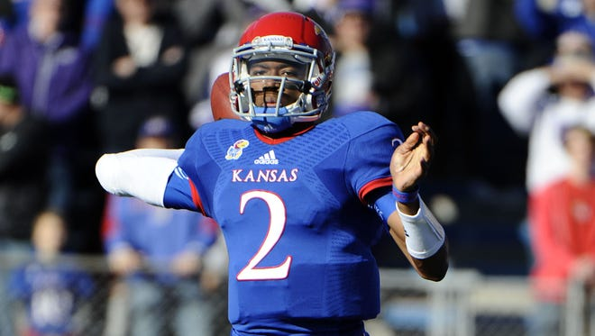 Kansas sophomore Montell Cozart (2) shapes up as the Jayhawks' starting quarterback for 2014. But the job might not be exclusively his.