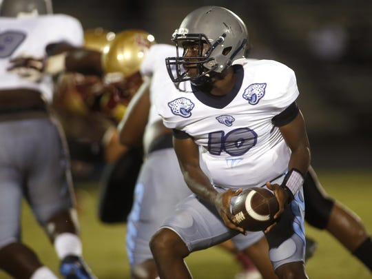 East Gadsden quarterback Thomas Jones looks to pitch the ball during a game against Florida High on Friday.