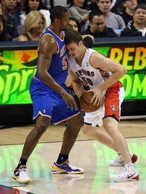 Oct 11, 2013; Toronto, Ontario, CAN; Toronto Raptors forward Tyler Hansbrough (50) runs into New York Knicks forward Metta World Peace (51) who defends at Air Canada Centre. The Raptors beat the Knicks 100-91.